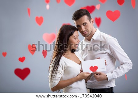 Couple in love with envelope - stock photo