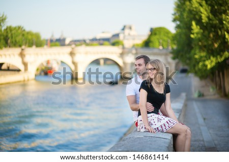 Couple in Paris on a summer day - stock photo