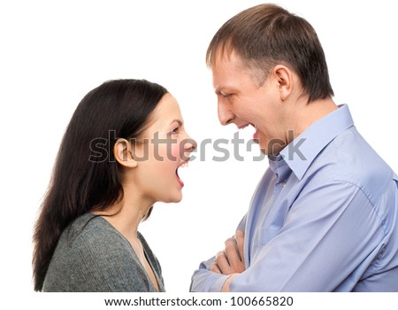 Couple in quarrel. Wife yelling at her husband, isolated on white background - stock photo