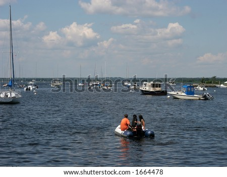 couple in raft/boat with dog
