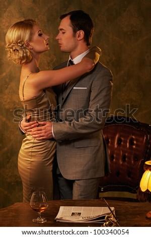 Couple in retro interior - stock photo