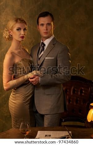 Couple in retro interior. - stock photo