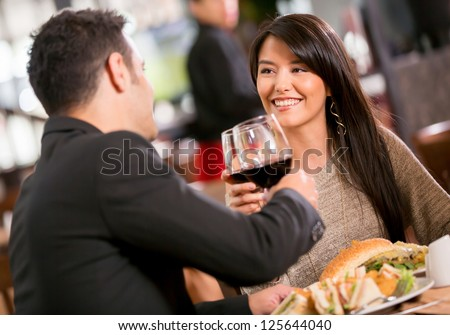 Couple in romantic dinner at a restaurant - stock photo