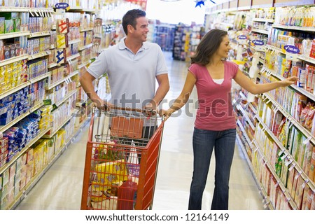 Couple in shopping in supermarket grocery aisle