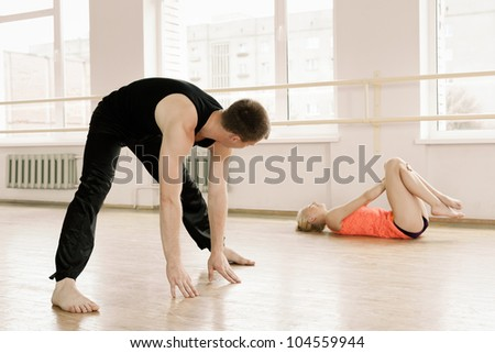couple in sportswear stretching in aerobics room - stock photo