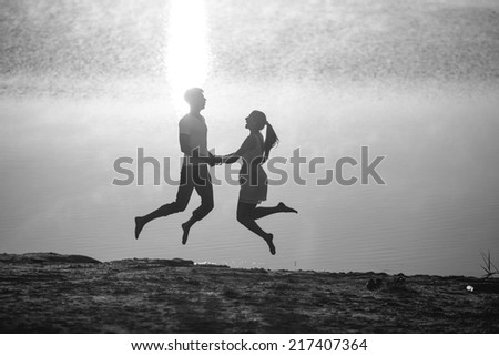 Couple in sunrise on the beach