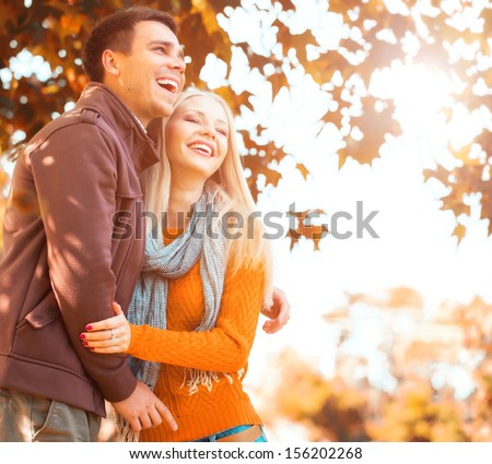 Couple in the autumn park - stock photo