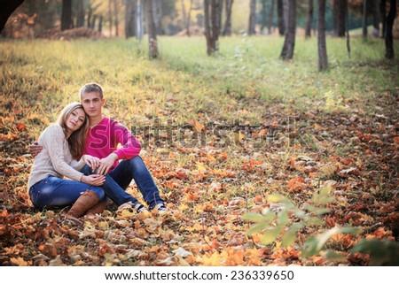 couple in the autumn park - stock photo