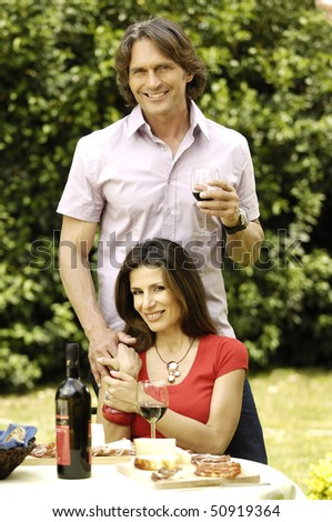 Couple in the garden - stock photo