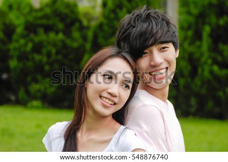 couple in the park on the grass, have a good time together