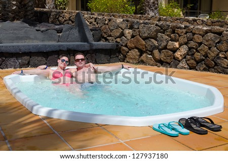 Couple in tropical jacuzzi