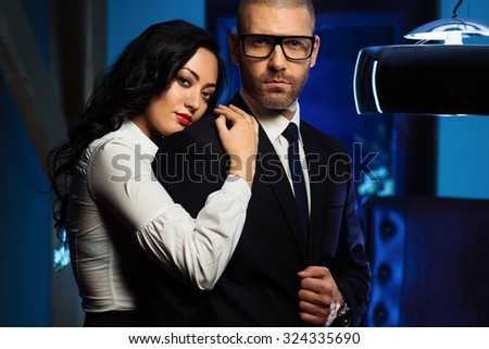 Couple indoors. Sensual brunette and handsome businessman - stock photo