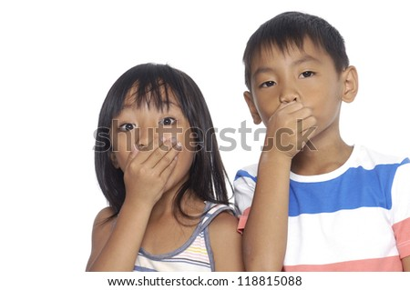 Couple kids covering her mouth over white background - stock photo