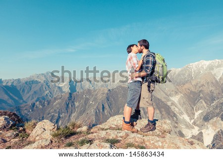 Couple Kissing at Top of Mountain - stock photo