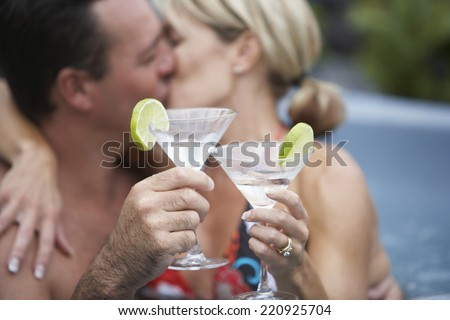 Couple kissing in hot tub - stock photo