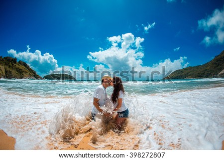 Couple kissing in the waves
