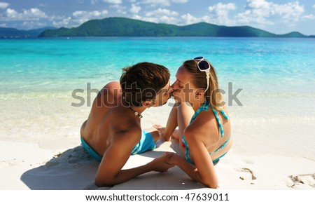 Couple kissing on a tropical beach