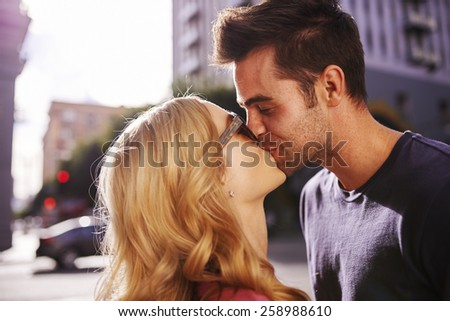 couple kissing on street in downtown los angeles close up