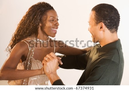 Couple laughing and dancing - stock photo