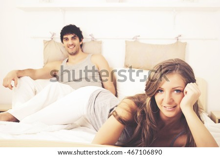 Couple laughing in bed and they are happy