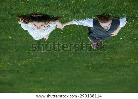 Couple laying on the grass.Young couple in love outdoor. - stock photo