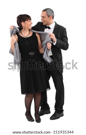 Couple leaving for an evening event - stock photo