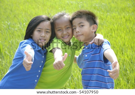 Couple little kid in the green rice fields - stock photo
