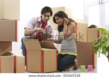 Couple looking at a photo frame - stock photo