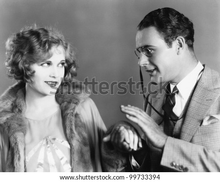 Couple looking at each other and holding hands - stock photo