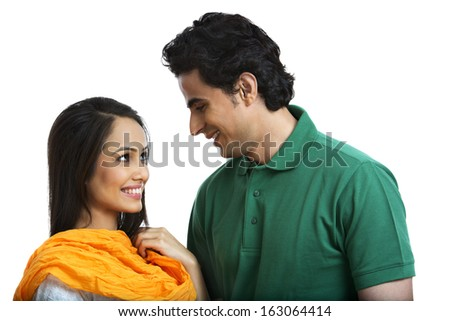 Couple looking at each other and smiling - stock photo