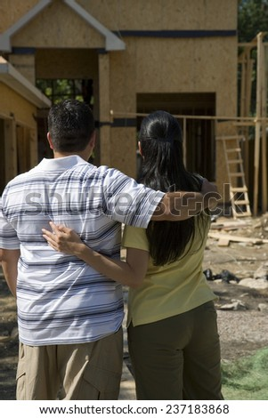 Couple Looking at New Home Construction - stock photo
