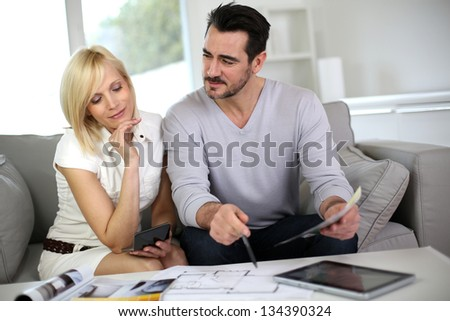 Couple looking at paint colors for new home - stock photo