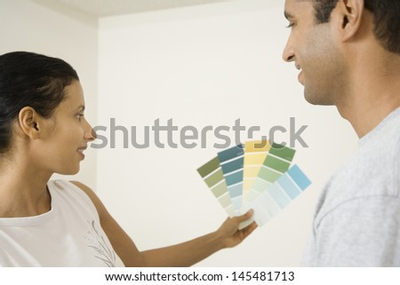 Couple looking at paint swatches