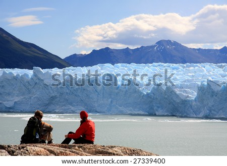 Couple looking at Perito Moreno Glacier, Patagonia, Argentina - stock photo