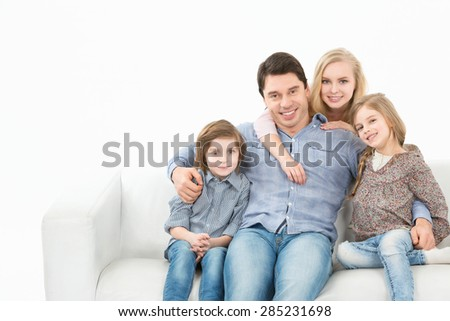 Couple looking at the camera isolated on white background - stock photo