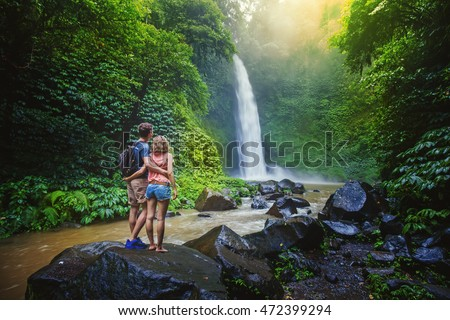 couple looking at the gorgeous waterfall