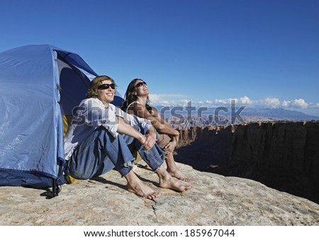 Couple Looking at View at Campsite - stock photo