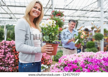 Couple looking from plants together in garden center