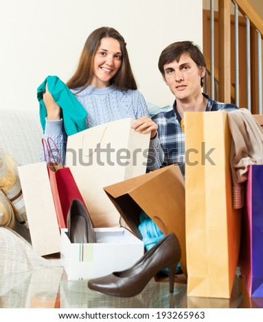 Couple looking their  purchases in home