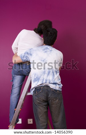 Couple looking to the new painted wall - stock photo