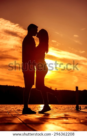 Couple Love Embrace, silhouette at sunrise - stock photo