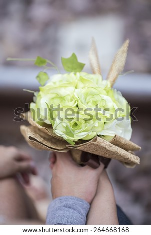 Couple lover holding wedding bouquet close up. - stock photo