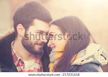 Couple loving each other outdoors. - stock photo