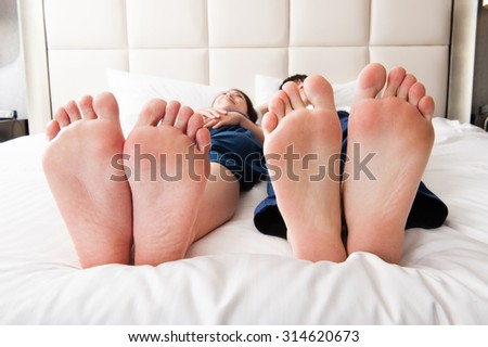 couple lying in the bed