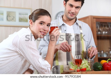 couple making a dinner - stock photo