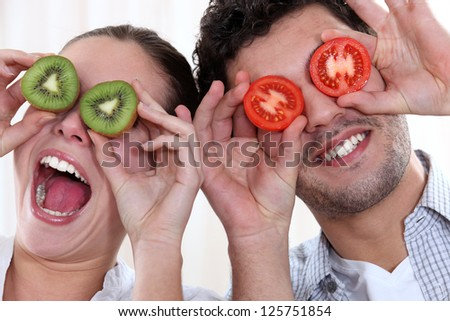 Couple making funny faces - stock photo