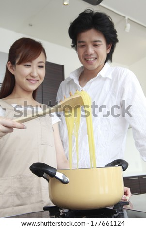 Couple making the pasta together
