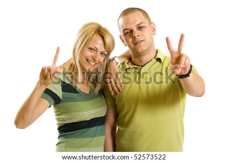 couple making their victory sign over white background