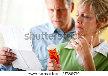 Couple: Man and Woman Concerned About Prescription - stock photo