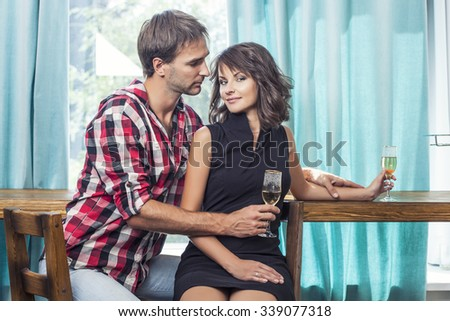 Couple man and woman in the bar with bacale communicate flirting - stock photo